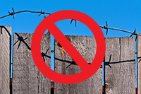 Example of a fence with barbed wire.