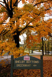 Shelby Bottoms Greenway sign under fall foliage