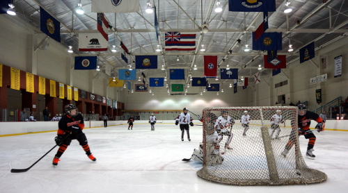 pee wee hockey game; children playing ice hockey