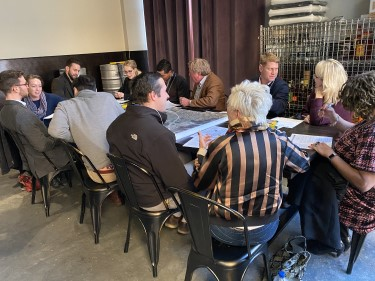 A group of community stakeholders discusses a map