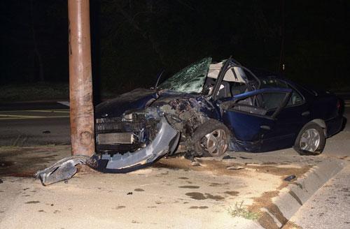 Car crashed into telephone pole at night